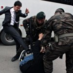 Yusuf Yerkel kicks a protester. Click to enlarge