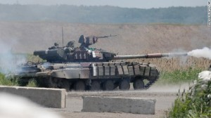 A Ukrainian tank opens fire during a battle with pro-Russian separatist fighters at Slovyansk, Ukraine, Friday, June 6, 2014. At least five Ukrainian soldiers were wounded, two of them heavily in this short clash with the pro-Russian separatist fighters. (AP Photo/Efrem Lukatsky). Click to enlarge