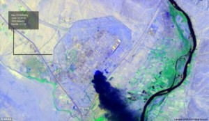 A satellite image shows a plume of smoke rising from Iraq's largest oil refinery. Click to enlarge