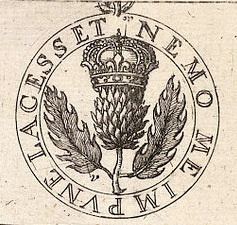 An Old Order of the Thistle Logo (Wikimedia Commons).
