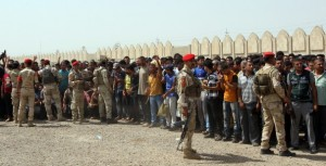 Volunteers gather outside a recruiting centre in Baghdad following calls by religous and polical leaders. Click to enlarge