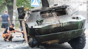 Military vehicle destroyed during clash between pro Russian separatists and Ukrtainian government forces near Mariupol on June 13. Click to enlarge