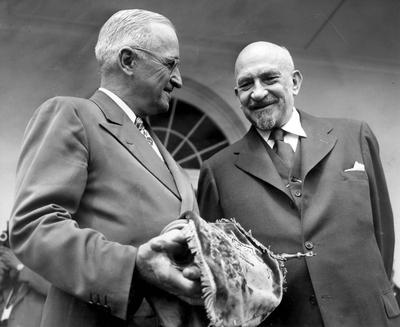 President Harry S. Truman and Israeli President Dr. Chaim Weizmann. Truman is holding a blue velvet mantle embellished with the Star of David. The mantle was a gift symbolizing Israel's gratitude for American recognition of and support for the new nation.