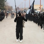 ISIL militants parade. Click to enlarge