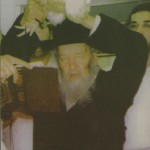 Kaporos shlugging: a rabbi transfer the karmic weight of sins to a chicken. Click to enlarge