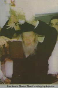 Kaporos shlugging: a rabbi transfer the karmic consequences of sins to a chicken. Click to enlarge