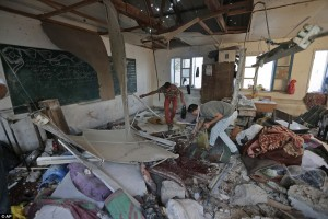 Palestinians collect body parts in a classroom at the Abu Hussein UN school. Click to enlarge