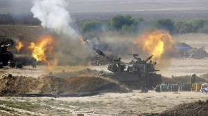 An Israeli mobile artillery unit fires on Gaza July 28. Click to enlarge