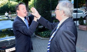 David Cameron greets Jean Claude Juncker at the EU Parliament. Click to enlarge