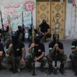 Hamas fighters sit during an anti Israel parade in Nov, 2013. Click to enlarge