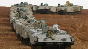 Israeli armour gathers near the Gaza Strip. Click to enlarge