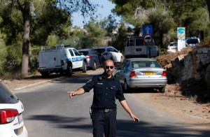 An Israeli police officer near the Jerusalem forest where a body was found after reports that an Arab teenager had been kidnapped. Click to enlarge