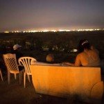 Israeli residents, mostly from the southern Israeli city of Sderot, sit on a hill overlooking the Gaza Strip, on July 12, 2014, to watch the fighting between the Israelis and Palestinians militants. Click to enlarge