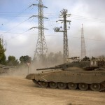 Israeli tanks move near the Israel and Gaza border Thursday, July 24, 2014. Israeli tanks and warplanes bombarded the Gaza Strip on Thursday. Later a U.N. school compound in Gaza was hit by IDF tanks shells, killing at least 15. Click to enlarge