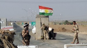 Kurdish Peshmerga forces man a checkpoint on the road leading from Kirkuk to the northern Iraqi city of Tikrit, June 20, 2014. Click to enlarge