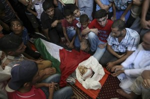 Relatives mourn over the body of Noor Alnajedy, 10,  who was killed during an Israeli air strike on  Rafah refugee camp, southern Gaza Strip, Friday July 11, 2014. Israel launched the Gaza offensive after three Israeli settler teens were kidnapped and murdered, although some commentators claim it was a 'false flag' to justify the latest Israeli offensive. Click to enlarge  (AP Photo/Eyad Baba)