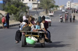 Palestinians flee their homes to take shelter in a United Nations school in Gaza City. Click to enlarge