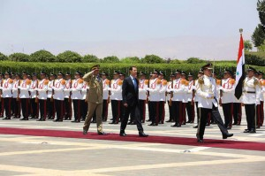 President Bashar Assad reviews the honor guard upon his arrival at the presidential palace to take the oath of office for his third, seven-year term. Click to enlarge