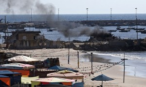 Smoke billows across the beach shortly after the Israeli gunboat's shelling. Click to enlarge