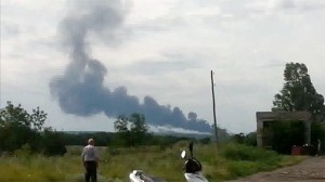Smoke rises above the crash site of what is thought to be the Malasia Airlines Boeing 777. Click to enlarge