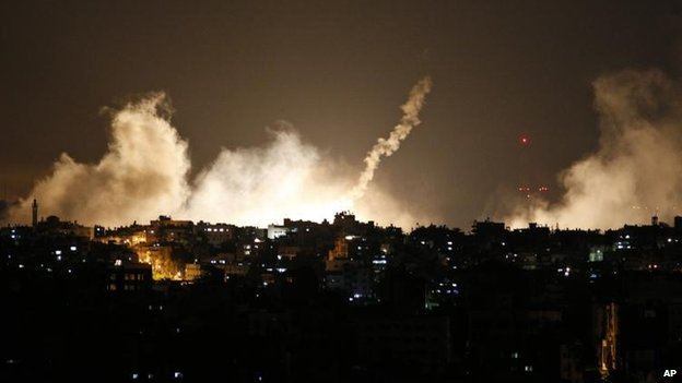 Smoke rises over Gaza as Israel announces Operation Protective Edge.