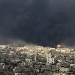 The smoke from battle drifts over Gaza. Click to enlarge