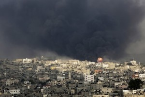 The smoke from battle drifts over Gaza