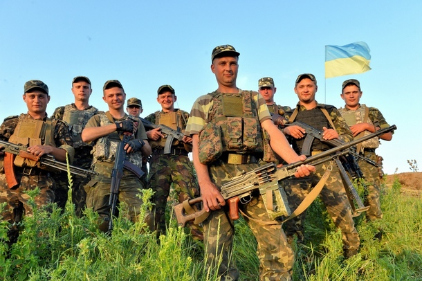 "Ukrainian ""anti-terrorist operation"" (ATO) forces pose for a photograph in the restive east of the country, where they have been fighting armed separatists since April."