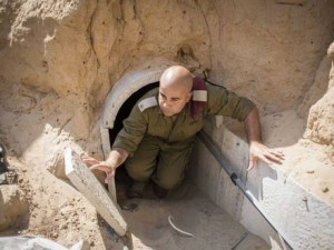 An IDF soldier exits one of the Hamas tunnels running from Gaza into Israel. Click to enlarge