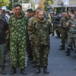 Armed pro Russian seperatists march Ukrainian POWs through Donetsk, Sunday, Aug 24, 2014. Click to enlarge