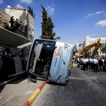 Overturned bus in Jerusalem after being tipped over by Palestinian construction worker. Click to enlarge