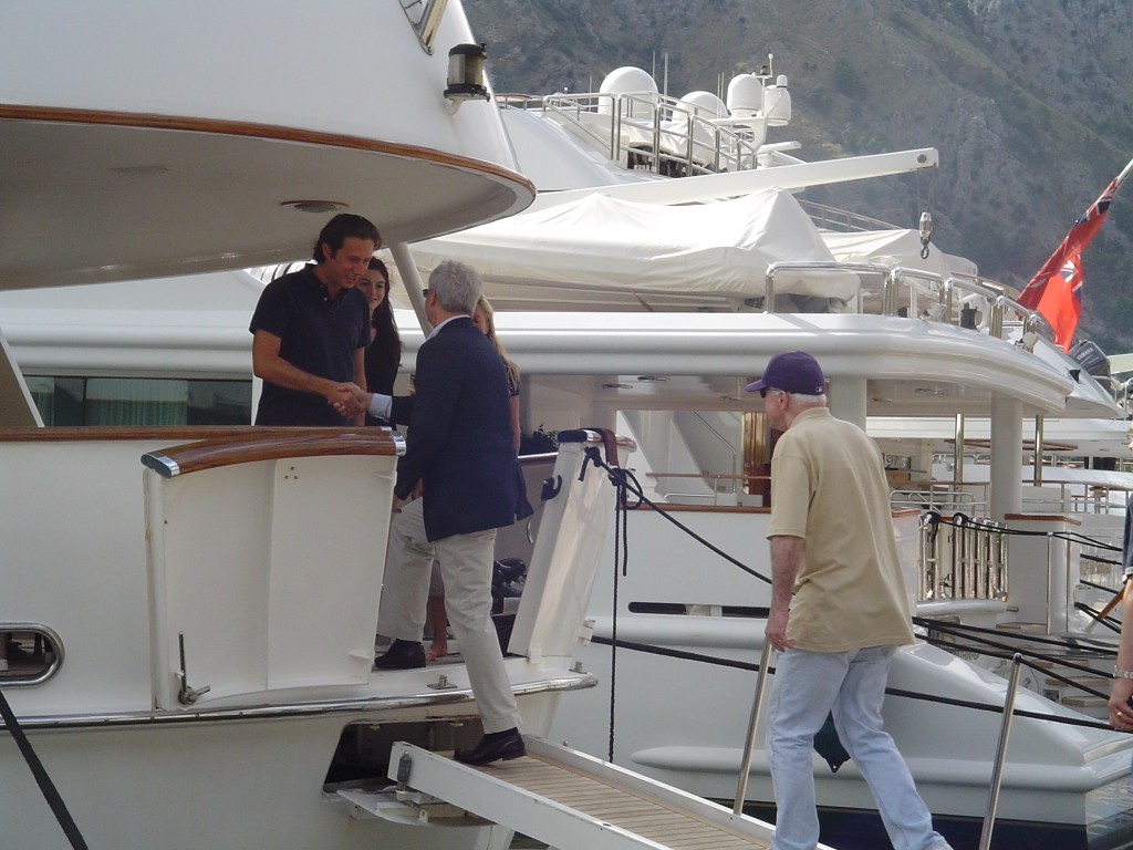 - Rick Davis and Sen. John McCain (in cap) board the rented yacht of Italian con man Raffaello Follieri in August 2006 in Kotor Bay, the Rothschild fiefdom in Montenegro. Follieri, then boyfriend of Anne Hathaway, went on to serve a five year federal jail term in the U.S. It was during this trip that McCain met again with Oleg Deripaska and Nathan Rothschild. Click to enlarge