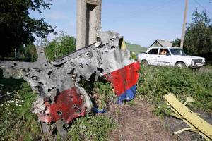 MH17 wreckage clearly shows signs of shrapnel or machinegun fire. Click to enlarge