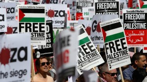 Pro-Palestinian protesters march in London Saturday. Click to enlarge