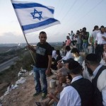 Ringside spectators: Israelis gather on a hillside overlooking Gaza to view the conflict. Click to enlarge