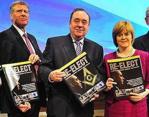 Former Scottish National party leader, Alex Salmond (center) with Justice Min. Kenny MacAskill and Deputy Nicola Sturgeon (now leader). Note the Masonic symbol being held by Salmond.