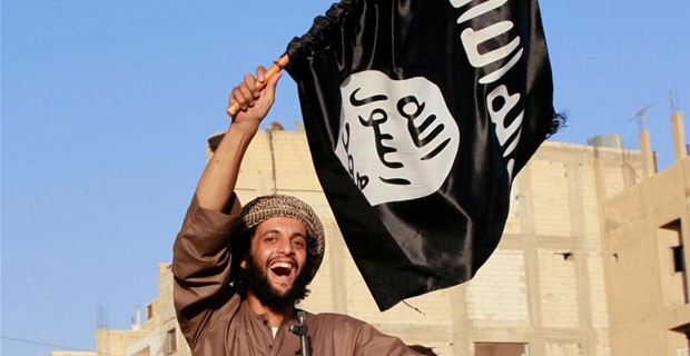 Militant with ISIS flag. Click to enlarge