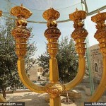A large full-sized Menorah candelabra, designed to burn olive oil - weighing half a tonne, covered in 92 Lbs of pure gold, and worth $2 million sits in a glass case. Click to enlarge overlooking the Western Wall. It awaits placement in the Third Temple to be built on the site of the Dome of the Rock.