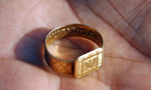 A golden ring inscribed in Hebrew which was unearthed by archaeologists at Sobibor. Photograph: Kacper Pempel/Reuters. Click to enlarge