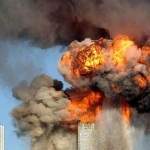 Hijacked airliner flies into the WTC. Click to enlarge