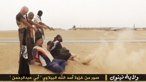 IS fighters execute prisoners. Click to enlarge