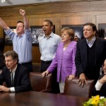Prime Minister David Cameron of the United Kingdom, President Barack Obama, Chancellor Angela Merkel of Germany, José Manuel Barroso, President of the European Commission, President François Hollande of France and others watch the overtime shootout of the Chelsea vs. Bayern Munich Champions League final, in the Laurel Cabin conference room during the G8 Summit at Camp David, Md., May 19, 2012.