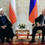 Russian President Vladimir Putin, right, and Iranian President Hassan Rouhani  meet at the Shanghai Cooperation Organization summit in Dushanbe, Tajikistan. Click to enlarge