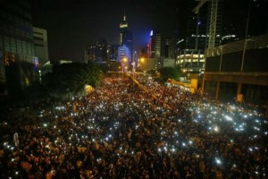 Protesters hold their mobile phones as they block the main street to the financial Central district, outside the government headquarters, in Hong Kong September 29, 2014. Click to enlarge