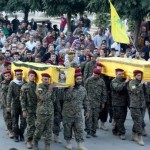 Hezbollah and their supportersd carry the coffins of fallen comrades through Baalbek. Click to enlarge