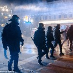 German police used water cannon during clashes in Hamburg between Kurdush portesters and IS supporters. Click to enlarge