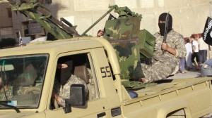 Islamic militants take part in a military parade in Syria's northern Raqqa province June 30, 2014. Click to enlarge