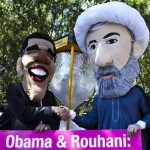 Member of Zionist advocacy group Avaaz wearing masks of President Rouhani and President Obama protest outside the UN headquarters in New York. Click to enlarge
