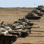Turkish tanks near the border with Syria. Click to enlarge