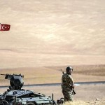 Turkish soldiers face Islamic State positions near Kobani. Click to enlarge